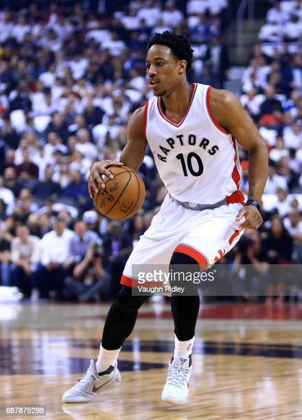 DeMar DeRozan of the Toronto Raptors dribbles the ball in the first half of Game Three of the Eastern Conference Semifinals against the Cleveland...