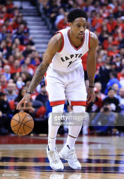 DeMar DeRozan of the Toronto Raptors dribbles the ball in the second half of Game Two of the Eastern Conference Quarterfinals against the Milwaukee...