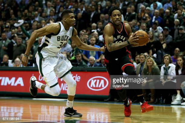 DeMar DeRozan of the Toronto Raptors dribbles the ball while being guarded by Giannis Antetokounmpo of the Milwaukee Bucks in the fourth quarter in...