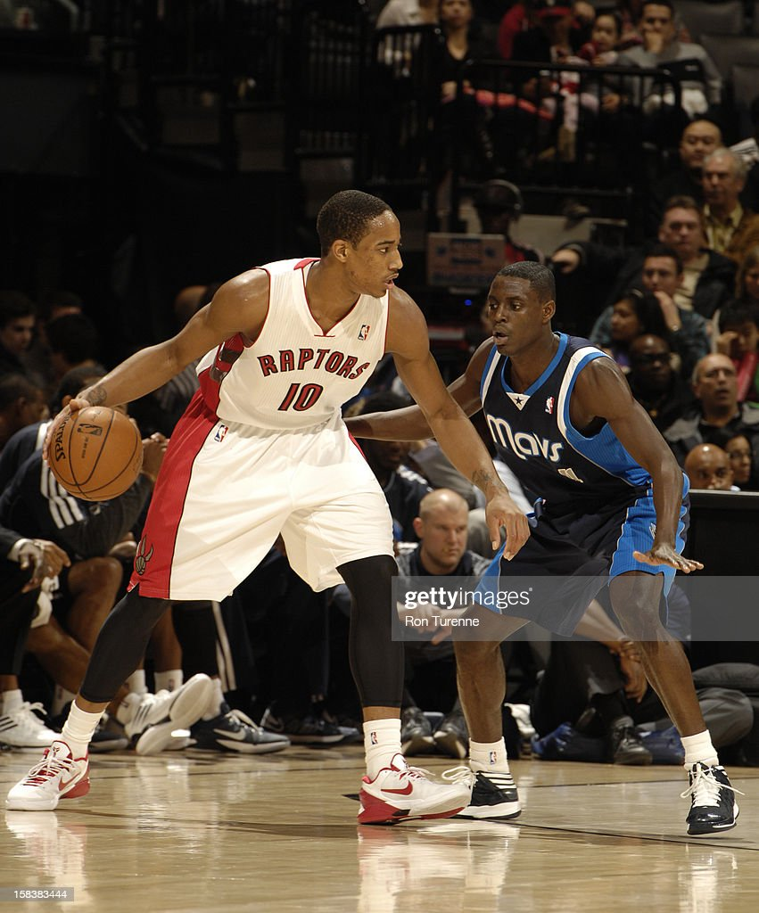 DeMar DeRozan #10 of the Toronto Raptors dribbles the ball while guarded by <a gi-track='captionPersonalityLinkClicked' href=/galleries/search?phrase=Darren+Collison&family=editorial&specificpeople=699031 ng-click='$event.stopPropagation()'>Darren Collison</a> #4 of the Dallas Mavericks on December 14, 2012 at the Air Canada Centre in Toronto, Ontario, Canada.