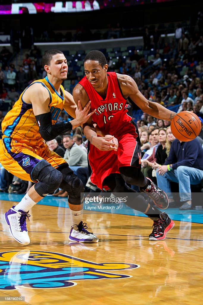 DeMar DeRozan #10 of the Toronto Raptors drives against Austin Rivers #25 of the New Orleans Hornets on December 28, 2012 at the New Orleans Arena in New Orleans, Louisiana.