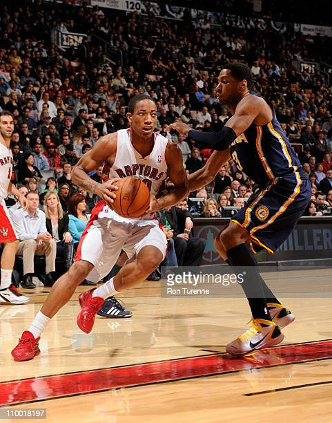DeMar DeRozan of the Toronto Raptors drives against Danny Granger of the Indiana Pacers on March 11 2011 at the Air Canada Centre in Toronto Ontario...