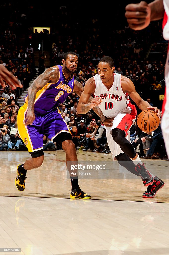 DeMar DeRozan #10 of the Toronto Raptors drives against Earl Clark #6 of the Los Angeles Lakers on January 20, 2013 at the Air Canada Centre in Toronto, Ontario, Canada.