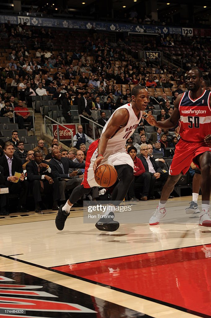 DeMar DeRozan #10 of the Toronto Raptors drives against <a gi-track='captionPersonalityLinkClicked' href=/galleries/search?phrase=Emeka+Okafor&family=editorial&specificpeople=201739 ng-click='$event.stopPropagation()'>Emeka Okafor</a> #50 of the Washington Wizards during a pre-season game on October 17, 2012 at the Air Canada Centre in Toronto, Ontario, Canada.