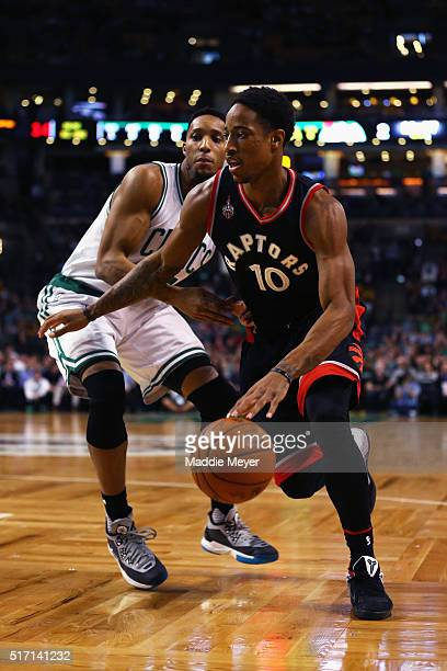 DeMar DeRozan of the Toronto Raptors drives against Evan Turner of the Boston Celtics during the first quarter at TD Garden on March 23 2016 in...