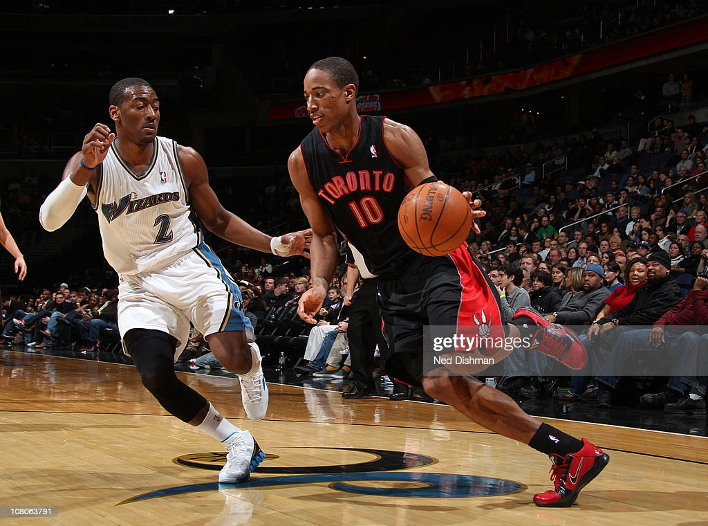 <a gi-track='captionPersonalityLinkClicked' href=/galleries/search?phrase=Demar+DeRozan&family=editorial&specificpeople=5088948 ng-click='$event.stopPropagation()'>Demar DeRozan</a> #10 of the Toronto Raptors drives against <a gi-track='captionPersonalityLinkClicked' href=/galleries/search?phrase=John+Wall&family=editorial&specificpeople=2265812 ng-click='$event.stopPropagation()'>John Wall</a> #2 of the Washington Wizards at the Verizon Center on January 15, 2011 in Washington, DC.
