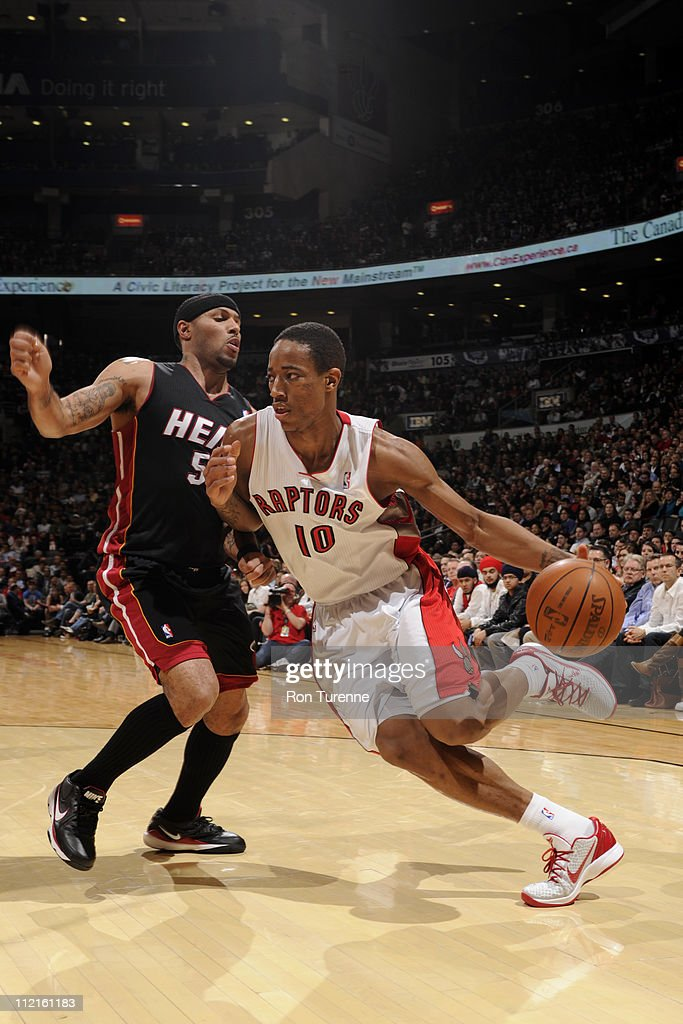 DeMar DeRozan #10 of the Toronto Raptors drives against <a gi-track='captionPersonalityLinkClicked' href=/galleries/search?phrase=Juwan+Howard&family=editorial&specificpeople=201642 ng-click='$event.stopPropagation()'>Juwan Howard</a> #5 of the Miami Heat during a game on April 13, 2011 at the Air Canada Centre in Toronto, Ontario, Canada.