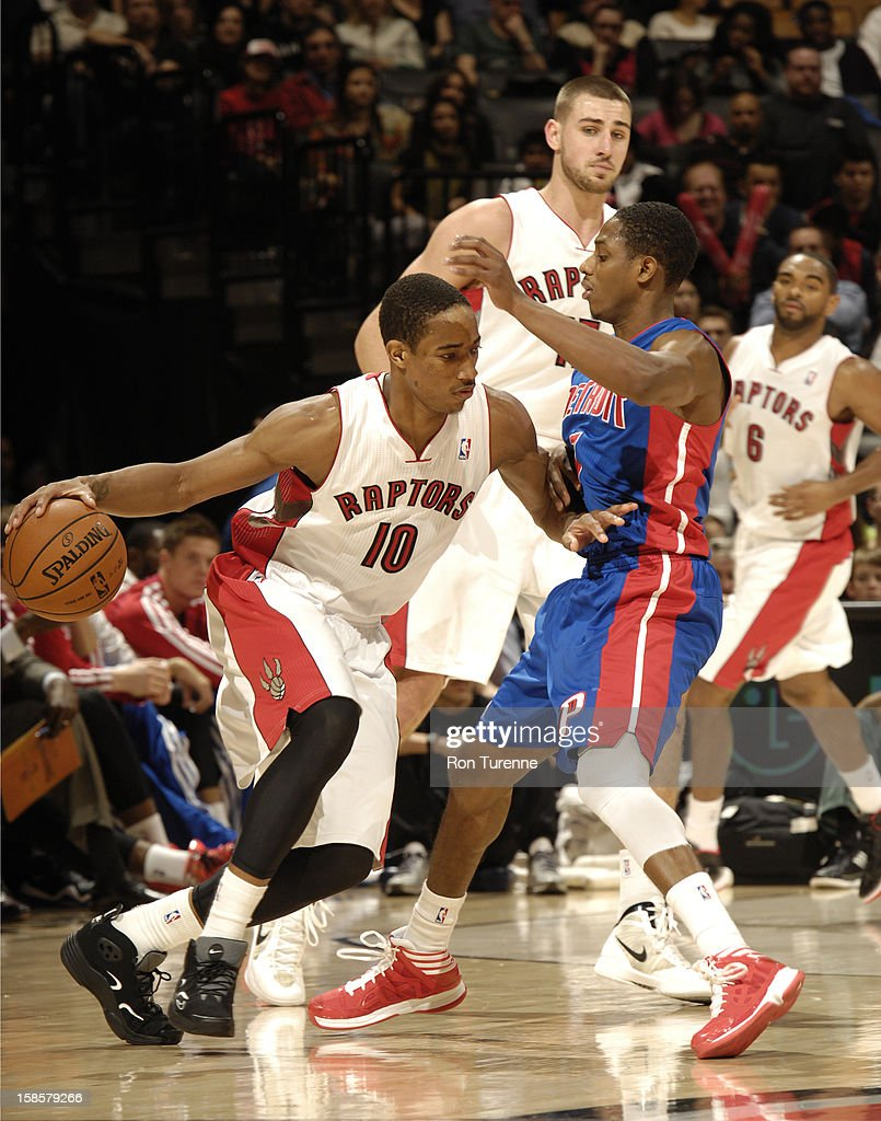 DeMar DeRozan #10 of the Toronto Raptors drives around one of Detroit Pistons during the game on December 19, 2012 at the Air Canada Centre in Toronto, Ontario, Canada.