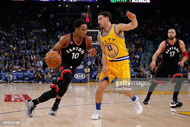 DeMar DeRozan of the Toronto Raptors drives on Klay Thompson of the Golden State Warriors at ORACLE Arena on November 17 2015 in Oakland California...