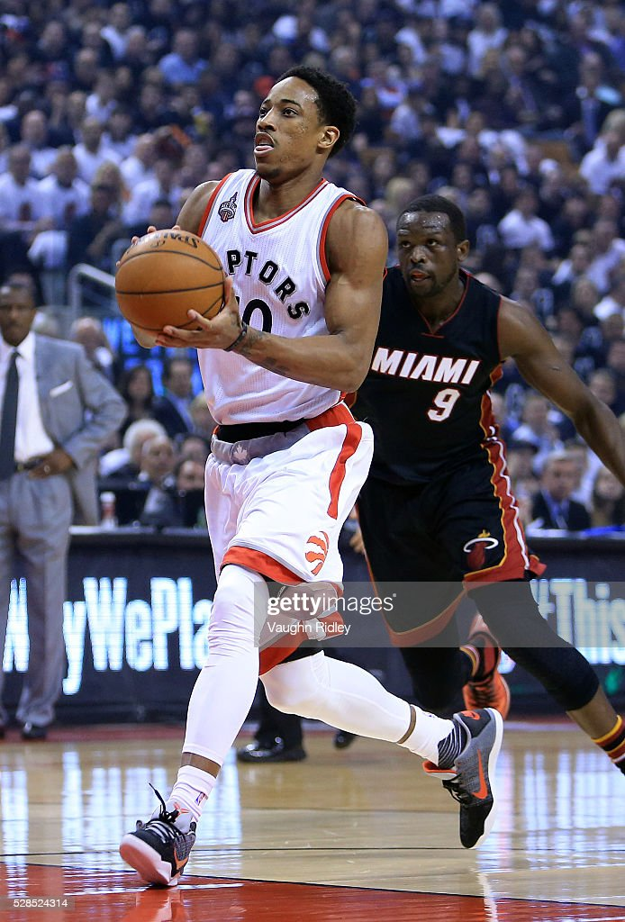 DeMar DeRozan #10 of the Toronto Raptors drives to basket as <a gi-track='captionPersonalityLinkClicked' href=/galleries/search?phrase=Luol+Deng&family=editorial&specificpeople=202830 ng-click='$event.stopPropagation()'>Luol Deng</a> #9 of the Miami Heat defends in the first half of Game Two of the Eastern Conference Semifinals during the 2016 NBA Playoffs at the Air Canada Centre on May 5, 2016 in Toronto, Ontario, Canada.