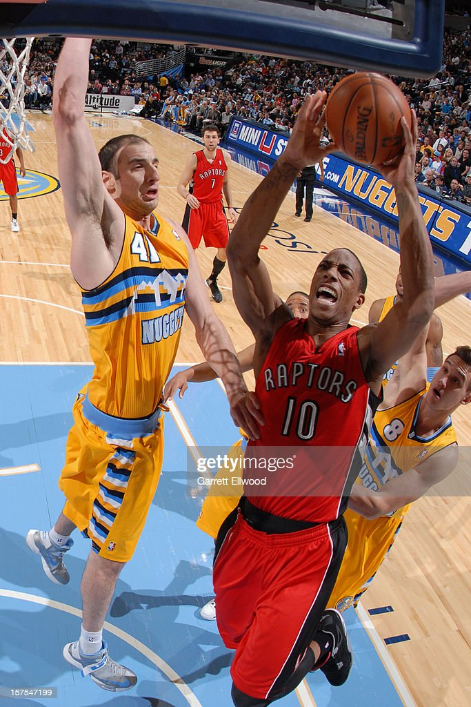 DeMar DeRozan #10 of the Toronto Raptors drives to the basket against Kosta Koufos #41 of the Denver Nuggets on December 3, 2012 at the Pepsi Center in Denver, Colorado.