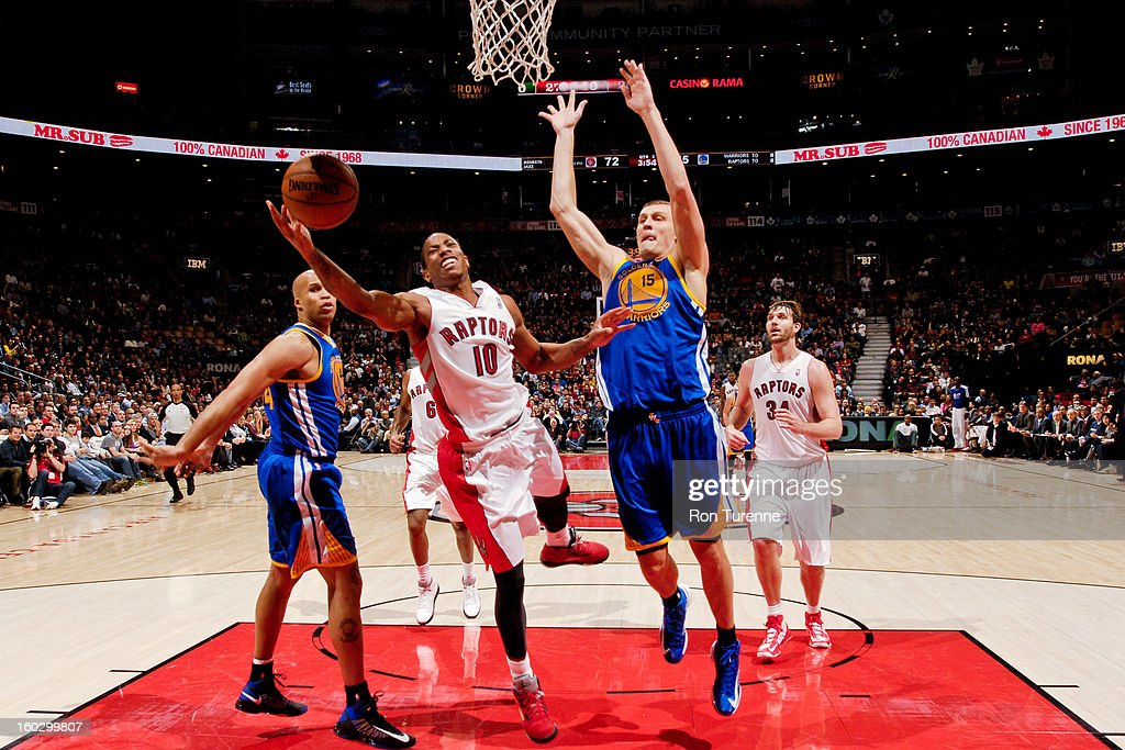 DeMar DeRozan #10 of the Toronto Raptors drives to the basket against <a gi-track='captionPersonalityLinkClicked' href=/galleries/search?phrase=Andris+Biedrins&family=editorial&specificpeople=204473 ng-click='$event.stopPropagation()'>Andris Biedrins</a> #15 of the Golden State Warriors on January 28, 2013 at the Air Canada Centre in Toronto, Ontario, Canada.