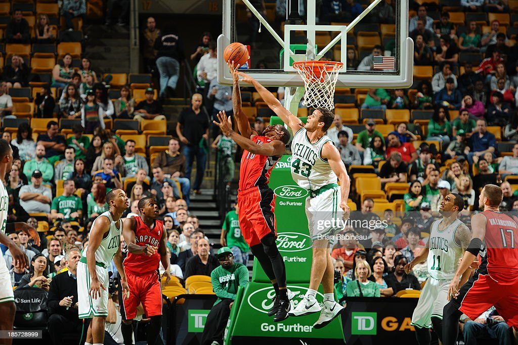 DeMar DeRozan #10 of the Toronto Raptors drives to the basket against Kris Humphries #43 of the Boston Celtics on October 7, 2013 at the TD Garden in Boston, Massachusetts.