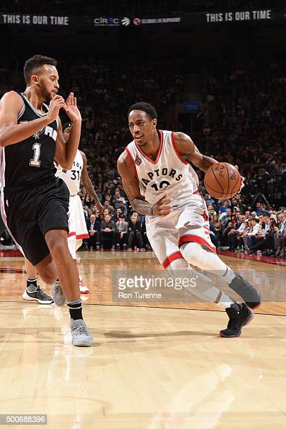 DeMar DeRozan of the Toronto Raptors drives to the basket against Kyle Anderson of the San Antonio Spurs on December 9 2015 at the Air Canada Centre...