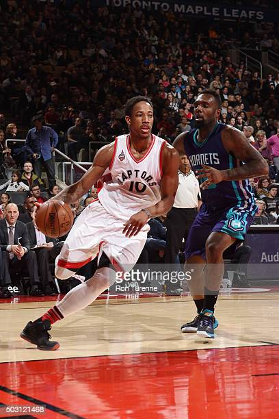 DeMar DeRozan of the Toronto Raptors drives to the basket against the Charlotte Hornets during the game on January 1 2016 at Air Canada Centre in...