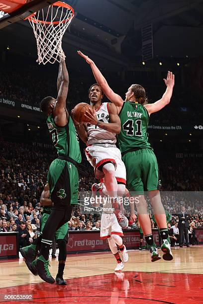 DeMar DeRozan of the Toronto Raptors drives to the basket against the Boston Celtics on January 20 2016 at the Air Canada Centre in Toronto Ontario...