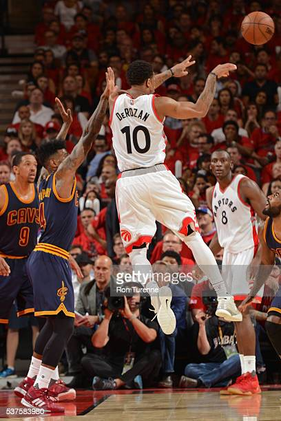 DeMar DeRozan of the Toronto Raptors drives to the basket and passes the ball against the Cleveland Cavaliers in Game Six of the NBA Eastern...