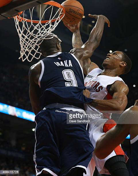 DeMar DeRozan of the Toronto Raptors drives to the basket as Serge Ibaka of the Oklahoma City Thunder defends during their game at Air Canada Centre...
