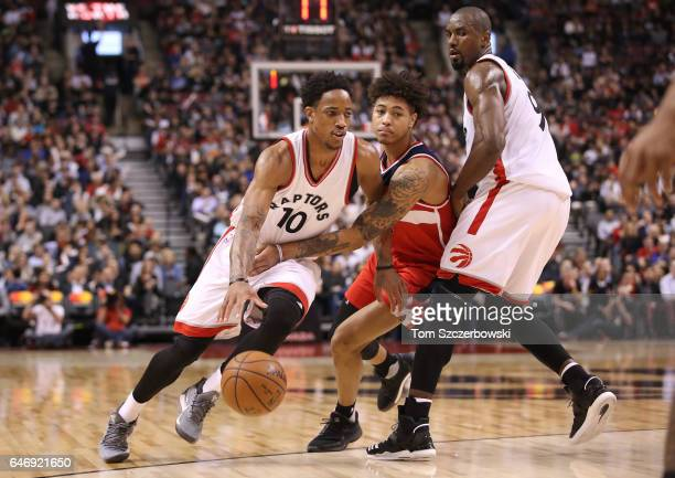 DeMar DeRozan of the Toronto Raptors drives to the basket as Serge Ibaka sets a pick of Kelly Oubre Jr #12 of the Washington Wizards during NBA game...