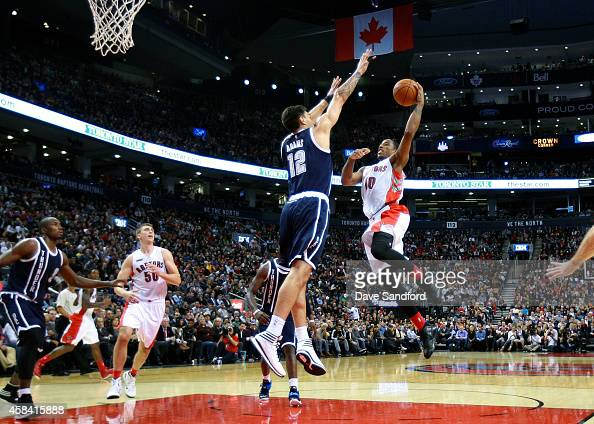 DeMar DeRozan of the Toronto Raptors drives to the basket as Steven Adams of the Oklahoma City Thunder defends during their game at Air Canada Centre...