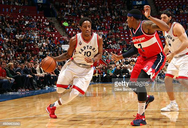 DeMar DeRozan of the Toronto Raptors drives to the basket past Bradley Beal of the Washington Wizards on October 23 2015 at Bell Centre in Montreal...