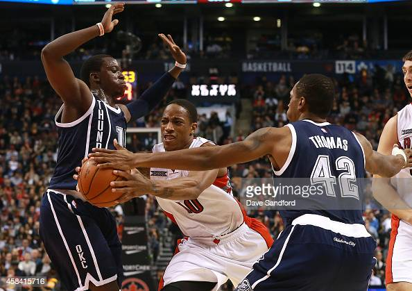 DeMar DeRozan of the Toronto Raptors drives to the basket past Lance Thomas of the Oklahoma City Thunder and Steven Adams of the Oklahoma City...