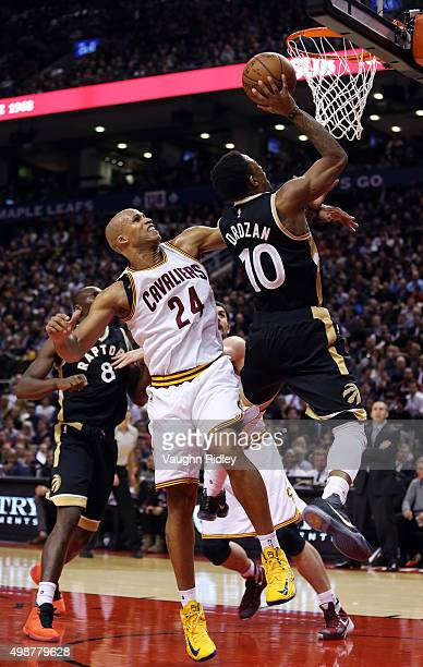 DeMar DeRozan of the Toronto Raptors drives to the basket past Richard Jefferson of the Cleveland Cavaliers during an NBA game at the Air Canada...