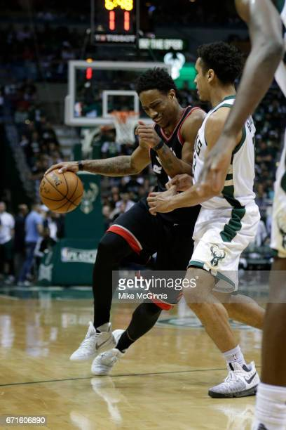 DeMar DeRozan of the Toronto Raptors drives to the hoop with Malcolm Brogdon of the Milwaukee Bucks defending during the second half of Game Four of...