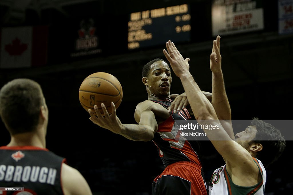 DeMar DeRozan #10 of the Toronto Raptors drives to the hoops and makes the outlet pass to Tyler Hansbrough #50 during the first half against the Milwaukee Bucks at Bradley Center on November 2, 2013 in Milwaukee, Wisconsin.