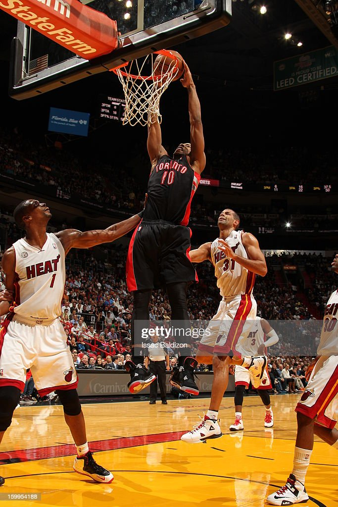 DeMar DeRozan #10 of the Toronto Raptors dunks against <a gi-track='captionPersonalityLinkClicked' href=/galleries/search?phrase=Chris+Bosh&family=editorial&specificpeople=201574 ng-click='$event.stopPropagation()'>Chris Bosh</a> #1 and <a gi-track='captionPersonalityLinkClicked' href=/galleries/search?phrase=Shane+Battier&family=editorial&specificpeople=201814 ng-click='$event.stopPropagation()'>Shane Battier</a> #31 of the Miami Heat on January 23, 2013 at American Airlines Arena in Miami, Florida.