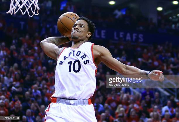 DeMar DeRozan of the Toronto Raptors dunks the ball in the first half of Game Five of the Eastern Conference Quarterfinals against the Milwaukee...