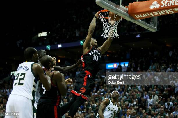 DeMar DeRozan of the Toronto Raptors dunks the ball in the fourth quarter against the Milwaukee Bucks in Game Six of the Eastern Conference...