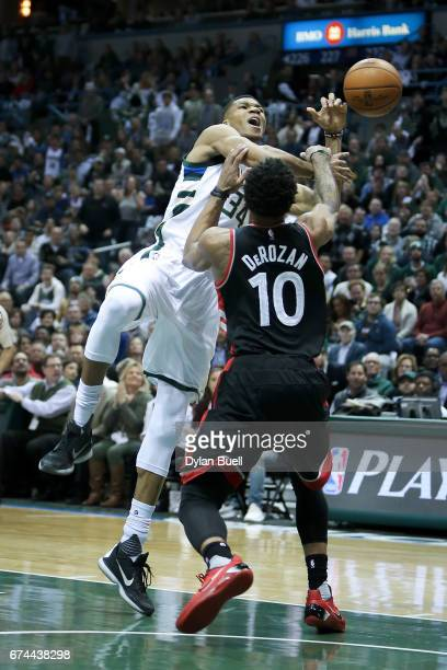 DeMar DeRozan of the Toronto Raptors fouls Giannis Antetokounmpo of the Milwaukee Bucks in the first quarter in Game Six of the Eastern Conference...