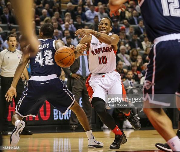 DeMar DeRozan of the Toronto Raptors gets fouled on the way to the paint byLance Thomas of the Oklahoma City Thunder at the Air Canada Centre during...