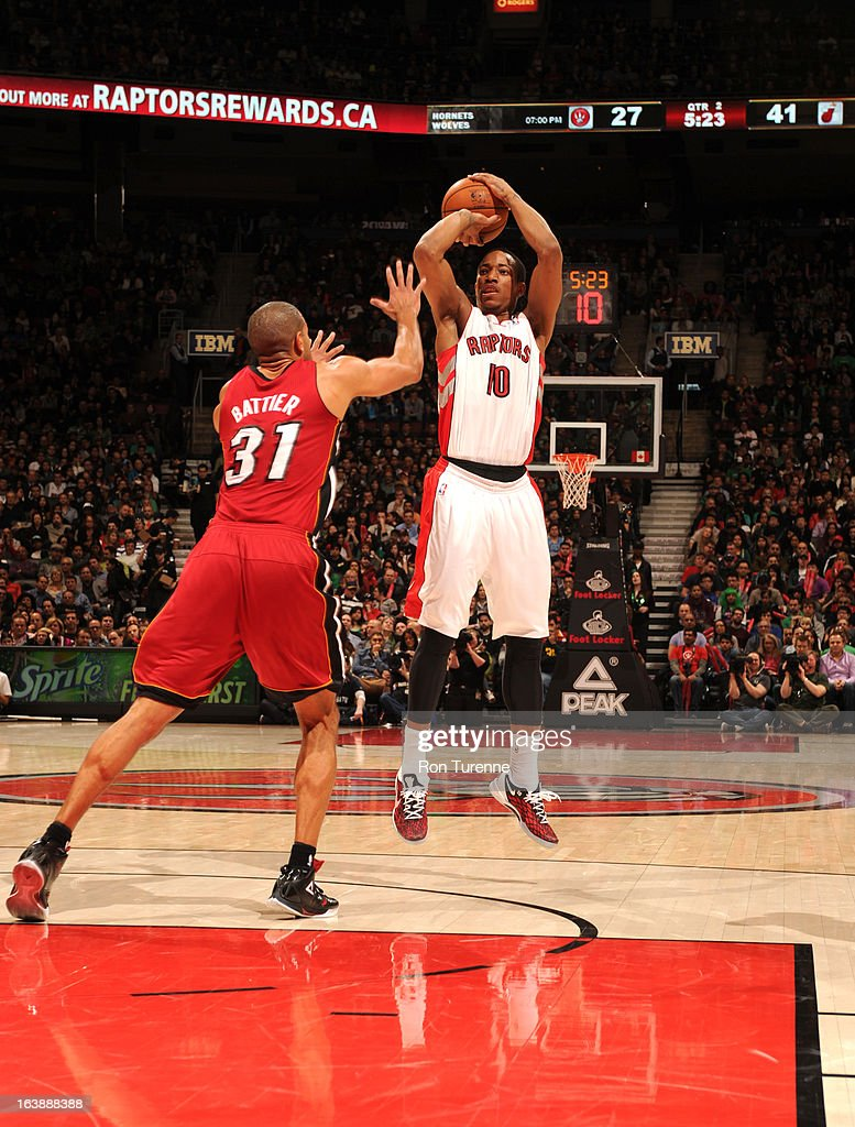 DeMar DeRozan #10 of the Toronto Raptors goes for a jump shot against Shane Battier #31 of the Miami Heat during the game between the Toronto Raptors and the Miami Heat on March 17, 2013 at the Air Canada Centre in Toronto, Ontario, Canada.