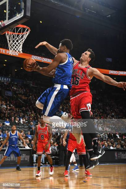 DeMar DeRozan of the Toronto Raptors goes for a lay up against Paul Zipser of the Chicago Bulls during the game on March 21 2017 at the Air Canada...