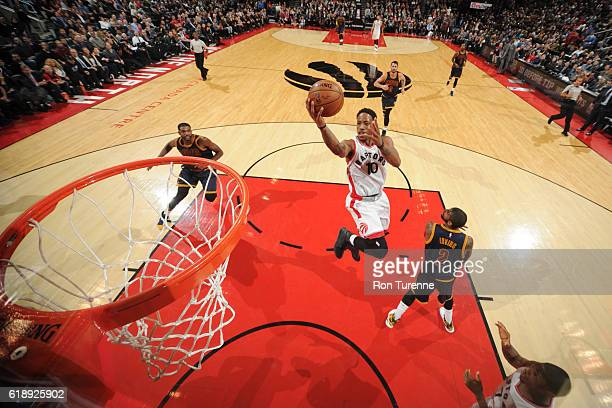 DeMar DeRozan of the Toronto Raptors goes for a lay up against the Cleveland Cavaliers on October 28 2016 at the Air Canada Centre in Toronto Ontario...