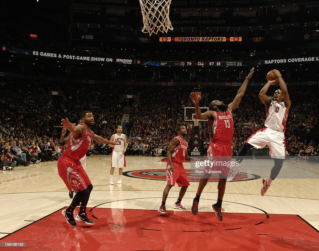 DeMar DeRozan #10 of the Toronto Raptors goes to the basket against <a gi-track='captionPersonalityLinkClicked' href=/galleries/search?phrase=James+Harden&family=editorial&specificpeople=4215938 ng-click='$event.stopPropagation()'>James Harden</a> #13 of the Houston Rockets during the game between the Toronto Raptors and the Houston Rockets December 16, 2012 at the Air Canada Centre in Toronto, Ontario, Canada.