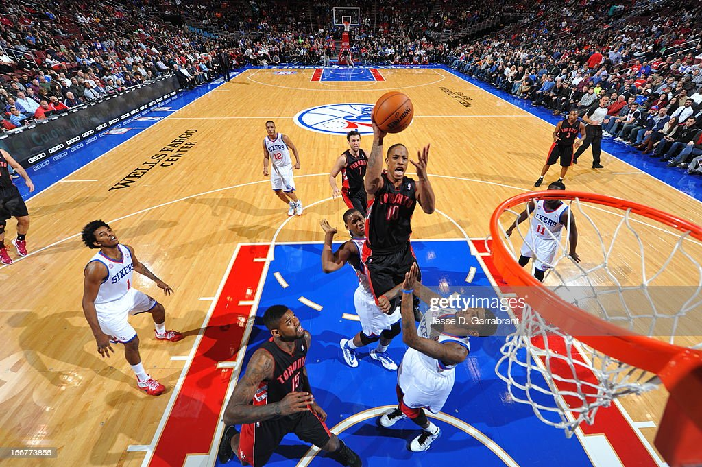 DeMar DeRozan #10 of the Toronto Raptors goes to the basket against Dorell Wright #4 of the Philadelphia 76ers at the Wells Fargo Center on November 20, 2012 in Philadelphia, Pennsylvania.