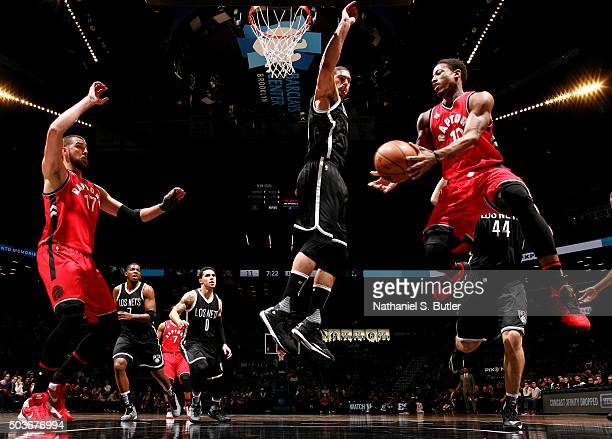 DeMar DeRozan of the Toronto Raptors goes to the basket against the Brooklyn Nets on January 6 2016 at Barclays Center in the Brooklyn borough of New...
