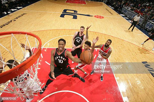 DeMar DeRozan of the Toronto Raptors goes to the basket against the Washington Wizards on November 2 2016 at Verizon Center in Washington DC NOTE TO...