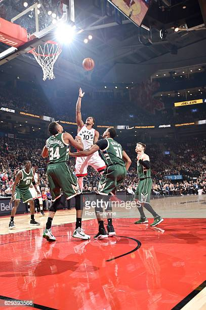 DeMar DeRozan of the Toronto Raptors goes to the basket against the Milwaukee Bucks on December 12 2016 at the Air Canada Centre in Toronto Ontario...