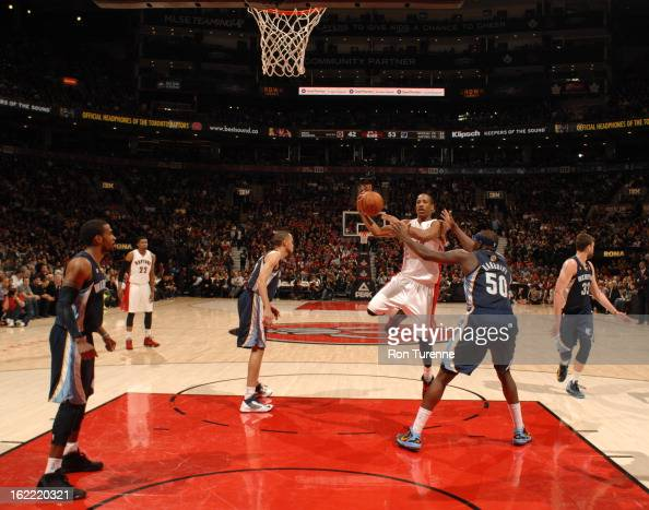 DeMar DeRozan of the Toronto Raptors goes to the basket against Zach Randolph of the Memphis Grizzlies on February 20 2013 at the Air Canada Centre...