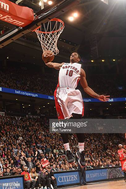 DeMar DeRozan of the Toronto Raptors goes up for a dunk against the Houston Rockets on March 2015 at the Air Canada Centre in Toronto Ontario Canada...