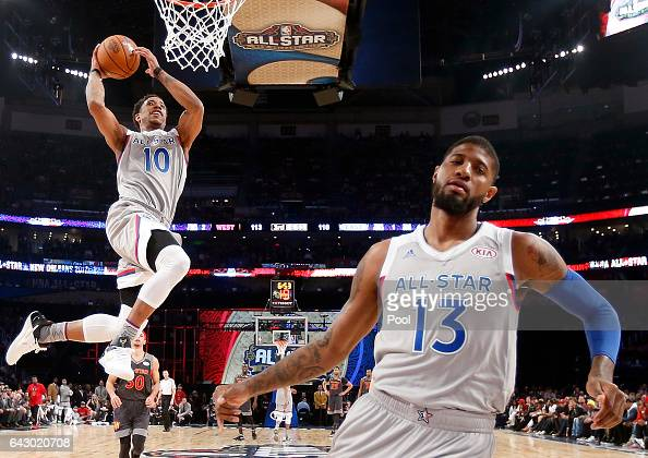 DeMar DeRozan of the Toronto Raptors goes up for a shot in front of Paul George of the Indiana Pacers during the 2017 NBA AllStar Game at Smoothie...