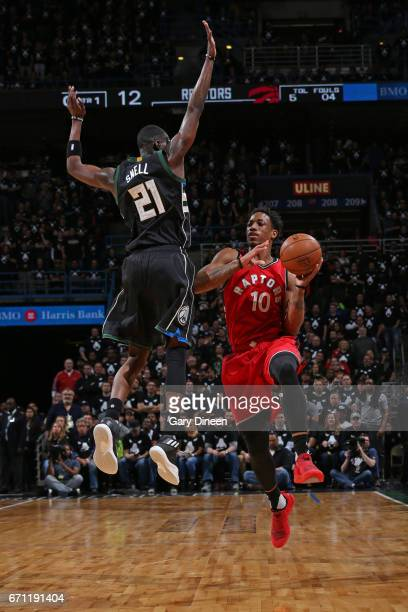 DeMar DeRozan of the Toronto Raptors goes up for a shot while defended by Tony Snell of the Milwaukee Bucks during Game Three of the Eastern...