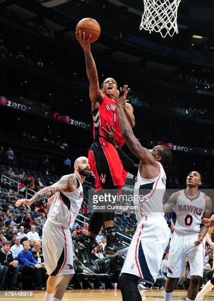 DeMar DeRozan of the Toronto Raptors goes up for the layup against the Atlanta Hawks on March 18 2014 at Philips Arena in Atlanta Georgia NOTE TO...