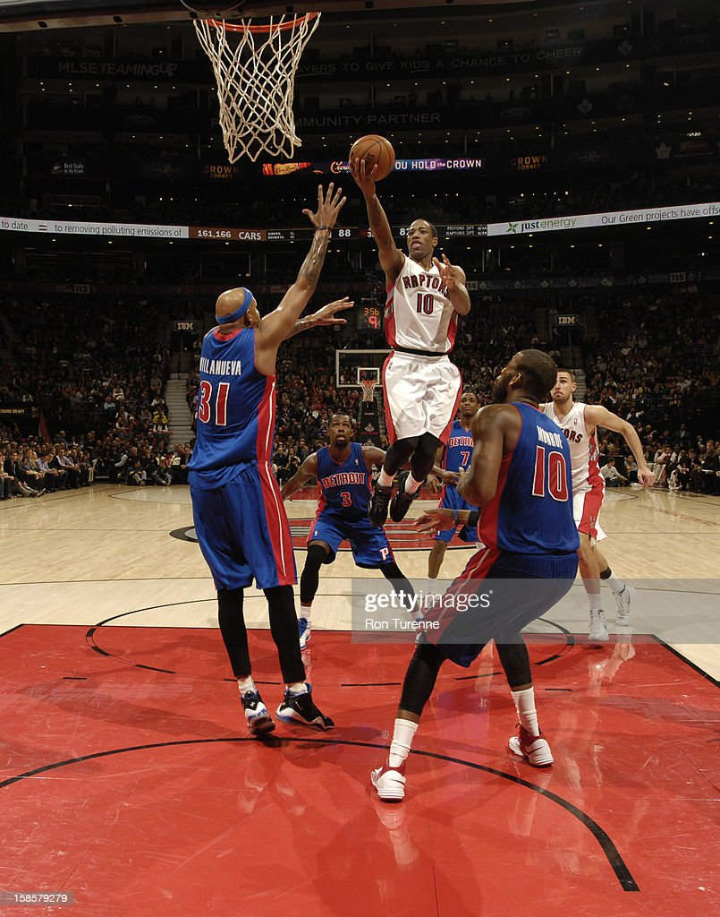DeMar DeRozan #10 of the Toronto Raptors goes up for the layup from the foul line against <a gi-track='captionPersonalityLinkClicked' href=/galleries/search?phrase=Charlie+Villanueva&family=editorial&specificpeople=215189 ng-click='$event.stopPropagation()'>Charlie Villanueva</a> #31 of Detroit Pistons during the game on December 19, 2012 at the Air Canada Centre in Toronto, Ontario, Canada.