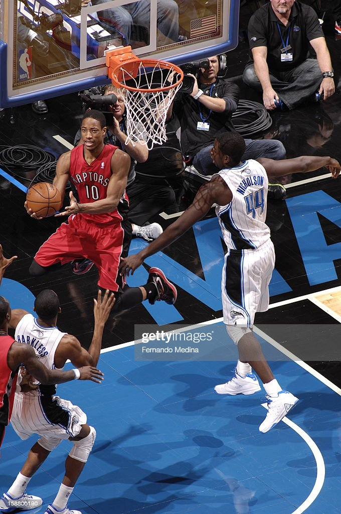 DeMar DeRozan #10 of the Toronto Raptors goes up for the reverse layup against the Orlando Magic during the game on December 29, 2012 at Amway Center in Orlando, Florida.