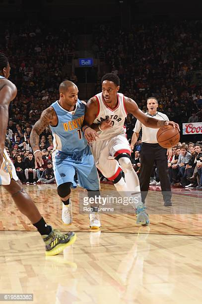 DeMar DeRozan of the Toronto Raptors handles the ball against Jameer Nelson of the Denver Nuggets during a game on October 31 2016 at the Air Canada...